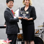 Mayor presents IRIS USA Chairman Akihiro Ohyama with a key to the city