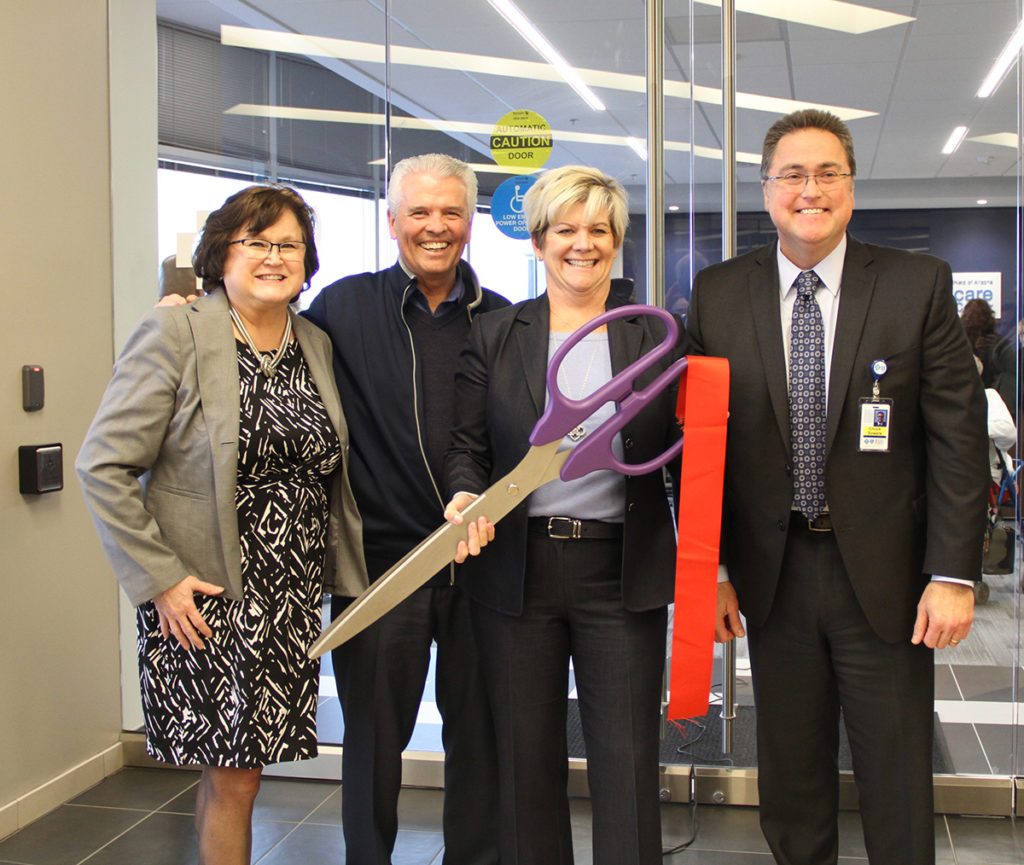 Mayor Skip Hall helping with the ribbon cutting for the newly remodeled Blue Cross Blue Shield of Arizona Advantage office