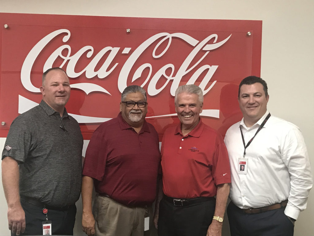 Mayor Hall poses with staff at the Swire Coca-Cola Distribution Factory in Glendale.