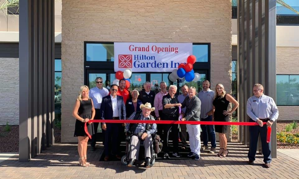 Mayor Hall prepared to cut the ribbon with City of Surprise Councilmembers at the Hilton Garden Inn grand opening.
