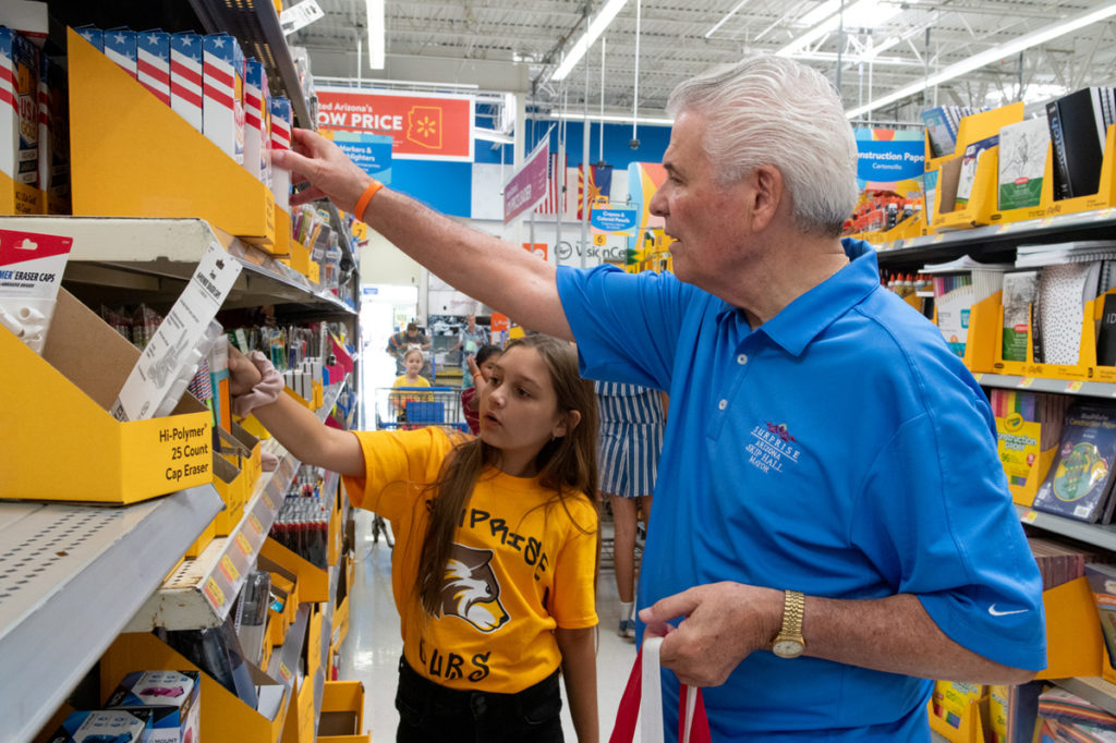 Mayor Hall shops with a student volunteer inside Walmart for the Fill the Bus Event.