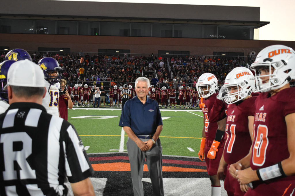 Mayor Hall conduct the coin toss at the start of the Ottawa University football game.