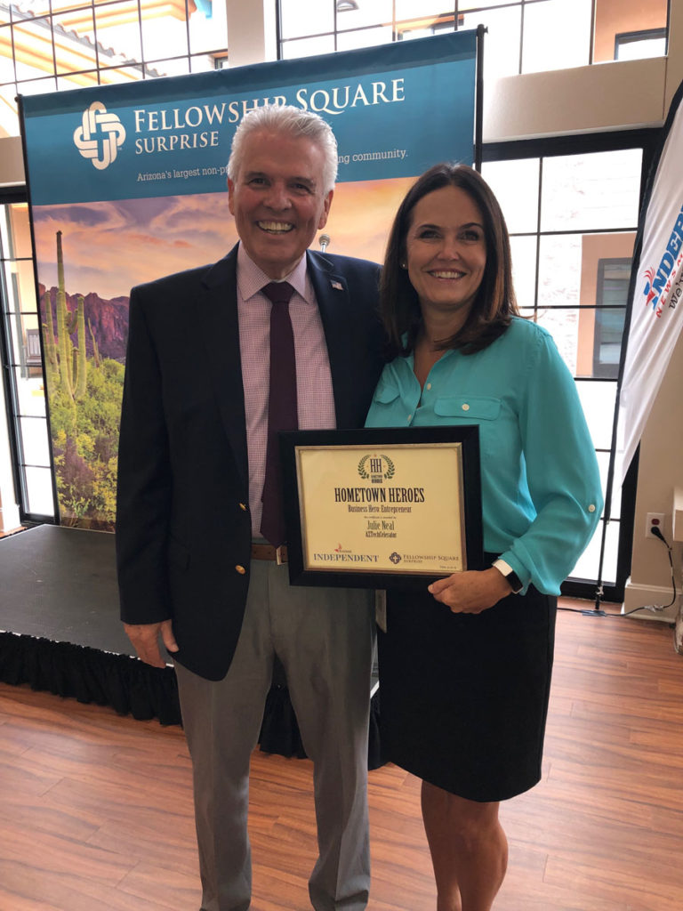Mayor Hall with Julie Neil, recipient of a Hometown Hero Award.