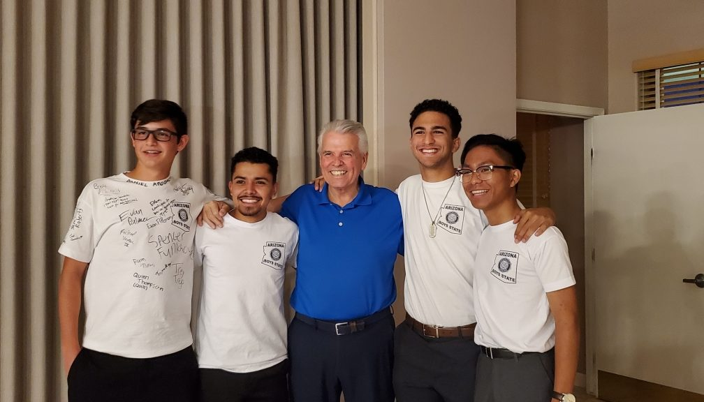 Mayor Hall stands with the four attendees of Boys State.