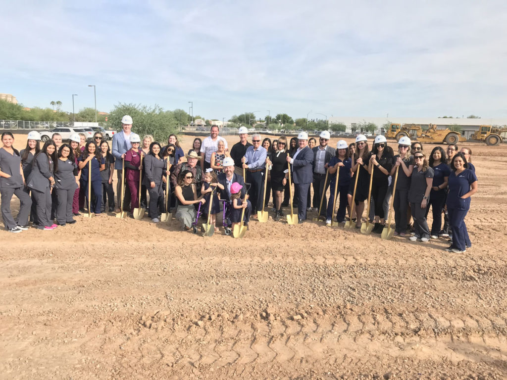 Auviana Medical Development staff and Surprise City Council break ground at the new site.