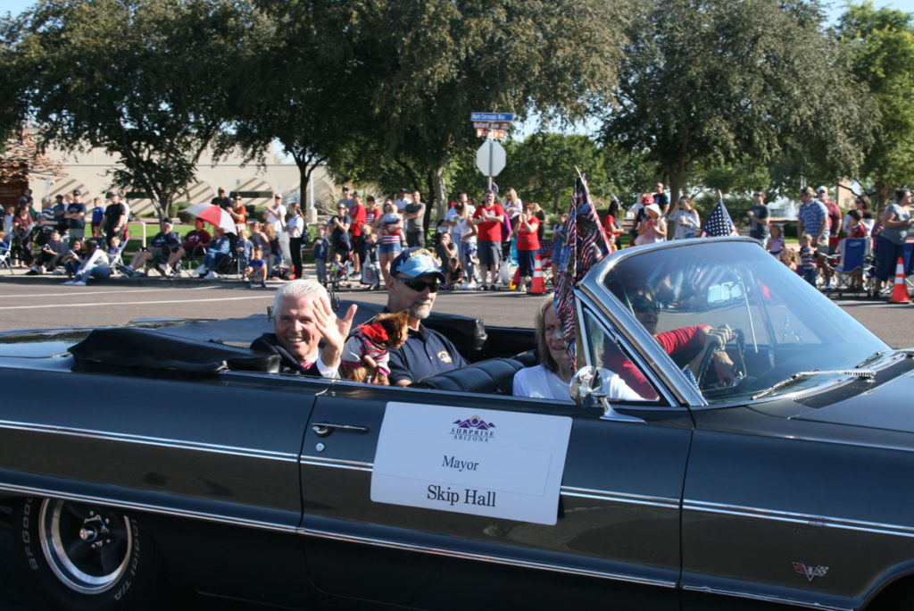 Mayor Hall waves to the crowd from his vehicle during the Veteran's Day Parade.
