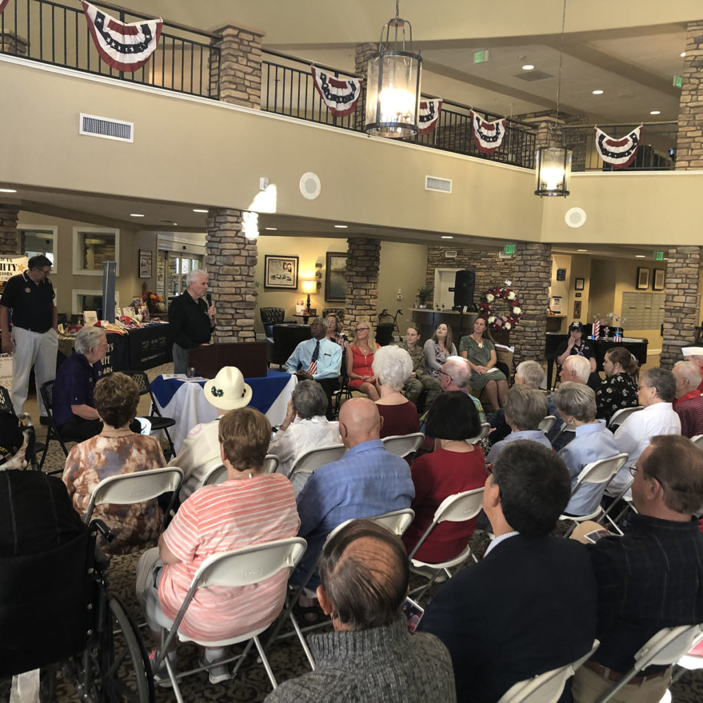 Attendees listen to Mayor Hall speak at Solana at the Park's 2nd Annual Veterans Celebration.
