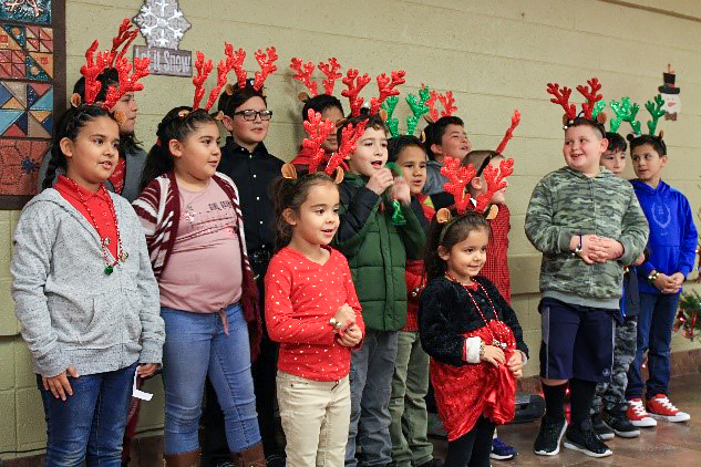 Children with red and green reindeer antlers at the Deck the Hock event.