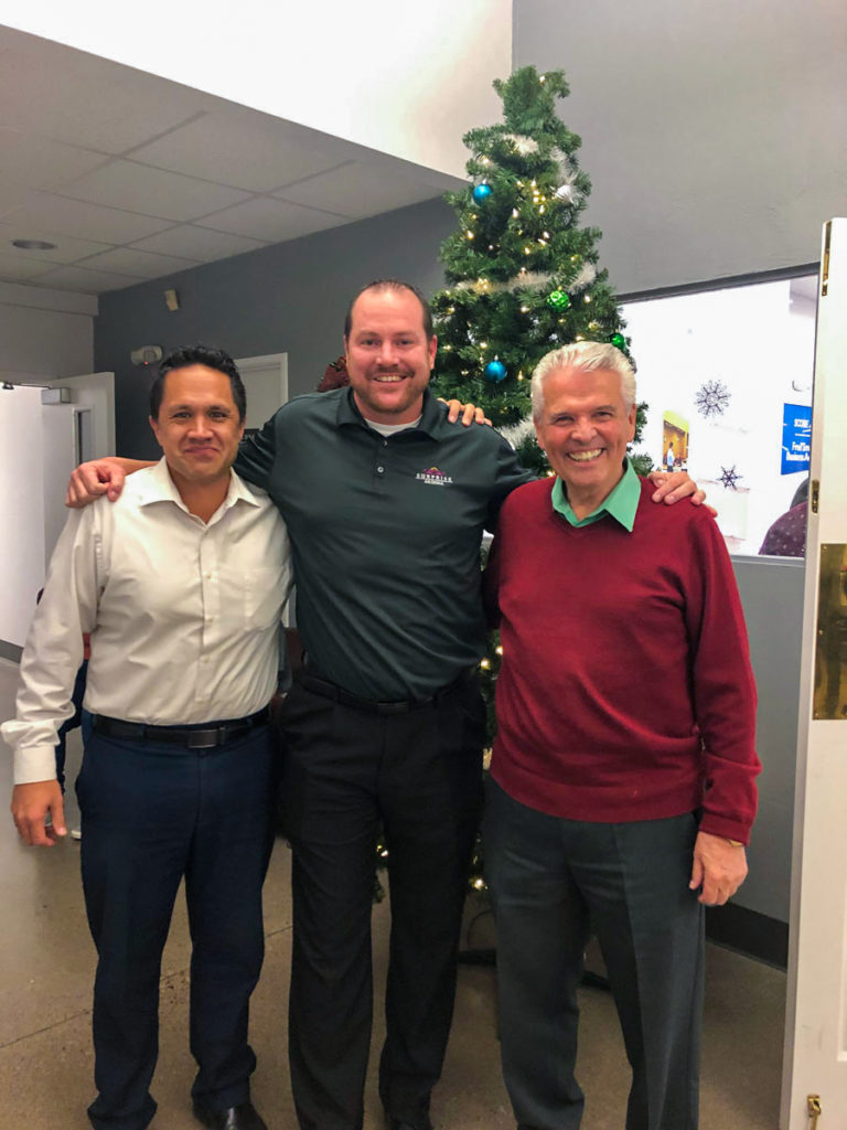 Councilmember Sanders, Duffy and Mayor Hall in front of the TechCelerator Christmas tree.