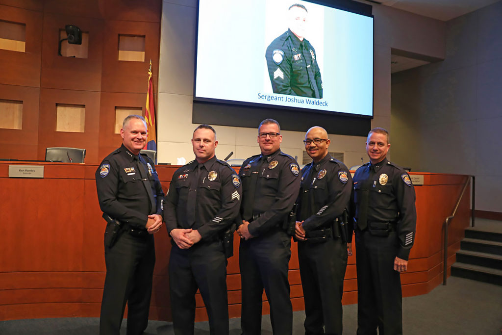 Police Chief Terry Young, Sergeant Joshua Waldeck and Surprise police officers.