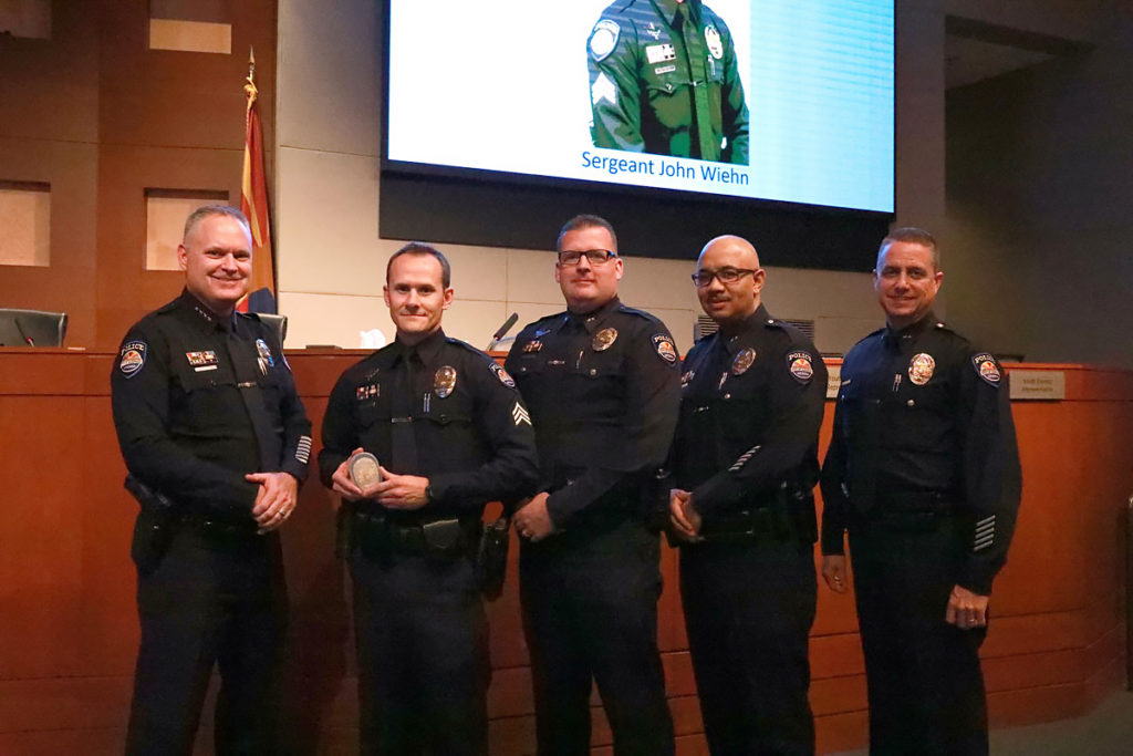 Chief of Police Terry Young, Sergeant John Wiehn and Surprise police officers.
