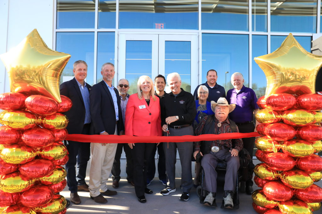 Mayor Hall, Congresswoman Debbie Lesko and Surprise City Councilmembers cut a grand opening ribbon.