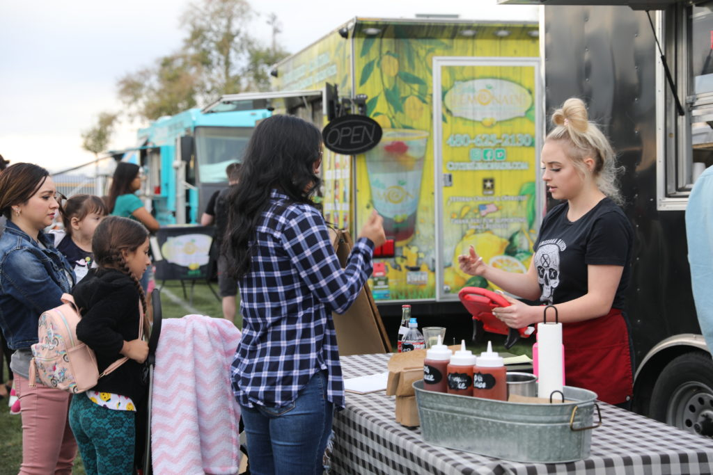 A woman places an order at a Sunday in the Park food truck.