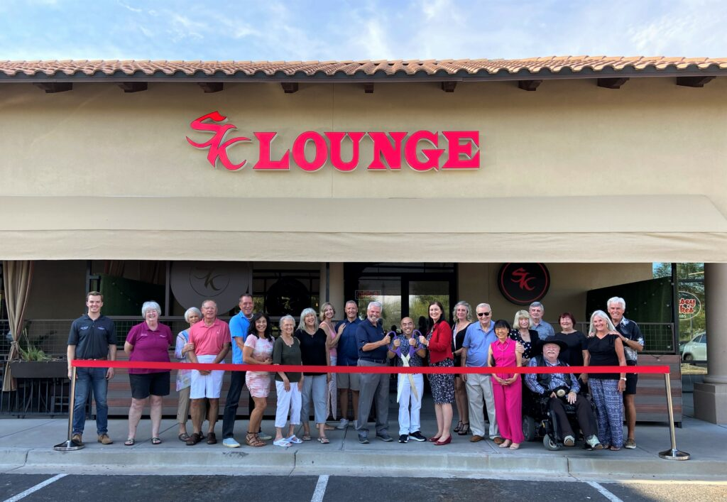 Surprise City Council and the economic development department join Saigon Kitchen to cut a ribbon for the opening of SK Lounge.